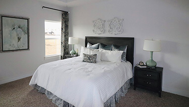 Master Bedroom with white coverlet and grey walls thumbnail
