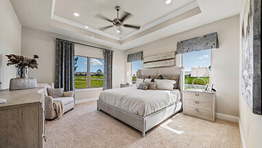 Master bedroom with beautiful windows in soft neutral tones thumbnail image